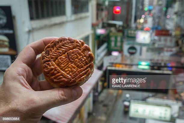 This picture shows a mooncake in Hong Kong on September 2 2016 It is a time of year when sugar and fatladen 'mooncakes' fill shelves and shop windows...