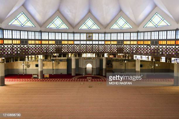 This picture shows a part of the deserted National Mosque at Friday Noon prayer time on the first day of Muslim's holy month of Ramadan during the...