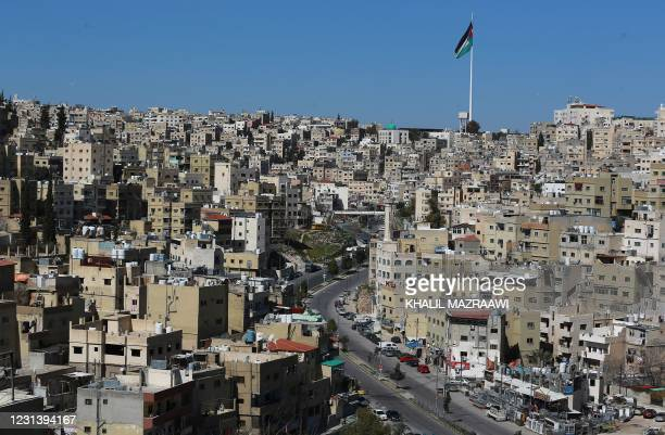 This picture shows a partial view of the Jordanian capital Amman and an almost deserted avenue during a lockdown due to the coronavirus panemic, on...