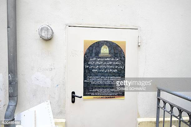 This picture shows a poster on a door in the compound of a mosque in Berlin on December 23 where Tunisian Anis Amri the suspected Christmas market...