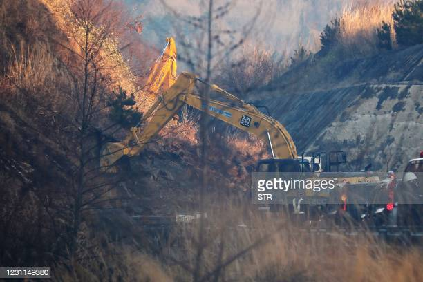 This picture shows a power excavator heavy equipment for restoration work at the landslide site on the Joban Expressway in Soma, Fukushima prefecture...