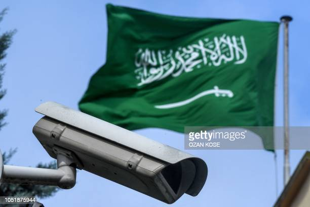 This picture shows a Saudi Arabia flag and a video camera surveillance at the backyard of the Saudi Arabian consulate on October 11 2018 in Istanbul...