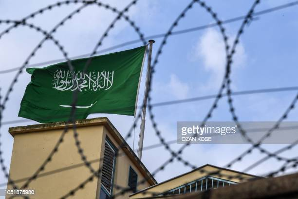 This picture shows a Saudi Arabia flag behind barbed wires at the backyard of the Saudi Arabian consulate on October 11 2018 in Istanbul Jamal...