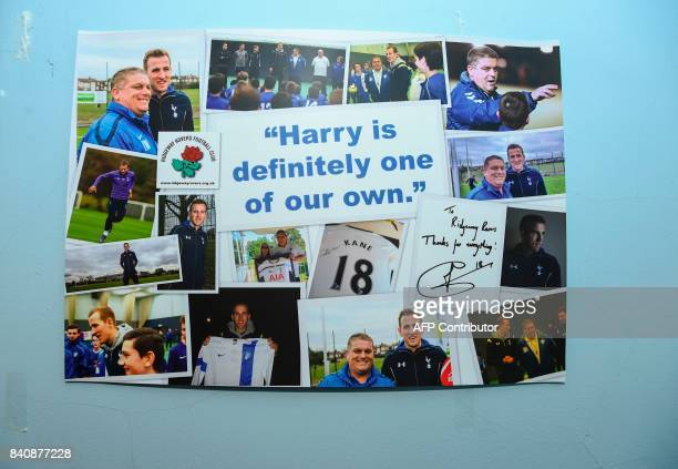 This picture shows a signed poster containing photographs of England striker Harry Kane visiting Ridgeway Rovers hung on the wall at Parmetors ground...