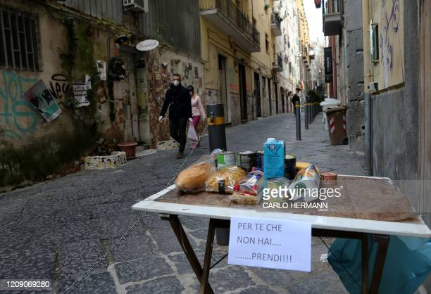 TOPSHOT This picture shows a solidarity table with a note reading For you who cannot buy take it in one of the deserted streets in the historic...