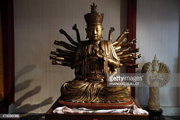 This picture shows a statue of a Buddha inside the Great Pagoda of the Vincennes wood after major renovation work in Paris on May 29 2015 AFP...