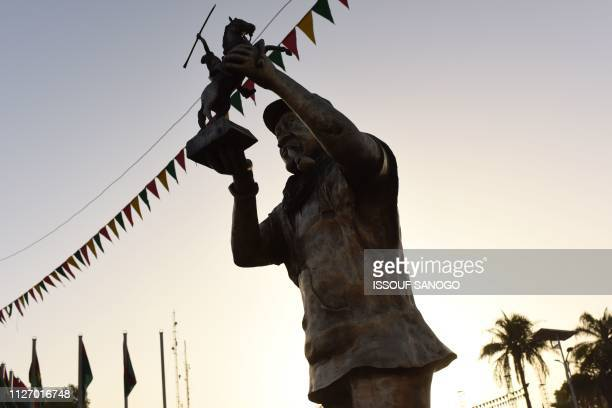This picture shows a statue of Senegalese director Ousmane Sembene on place des Cineastes in Ouagadougou during the Panafrican Film and Television...