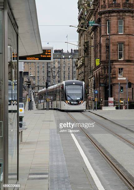 This picture shows a tram approaching the tram stop in St. Andrew Square, Edinburgh. Edinburgh Trams is a tramway undergoing preliminary testing in...