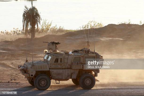 This picture shows a US army vehicle supporting the Syrian Democratic Forces in Hajin in the Deir Ezzor province eastern Syria on December 15 2018...