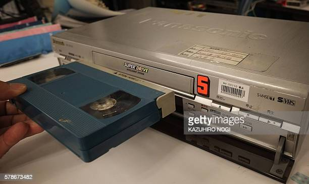 This picture shows a VHS videocassette recorder in Tokyo on July 22 2016 The world's last videocassette recorder is set to roll off the factory line...