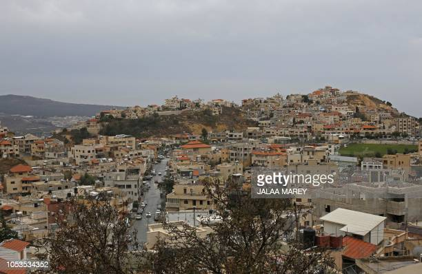 This picture shows a view of the Druze village of Majdal Shams on October 21 2018 in the Israeliannexed Golan Heights An election poster at the...