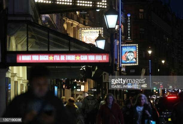 This picture shows a view of the Shaftesbury Avenue on March 12, 2020 in the theatres and restaurants district of West End in London. - Britain on...