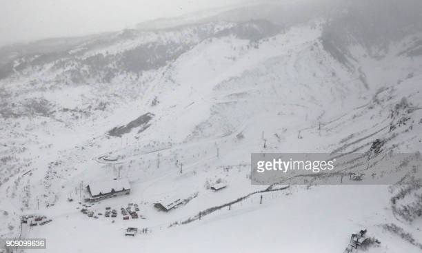 This picture shows an aerial view of a ski resort in the town of Kusatsu Gunma prefecture on January 23 2018 after a volcano erupted earlier in the...