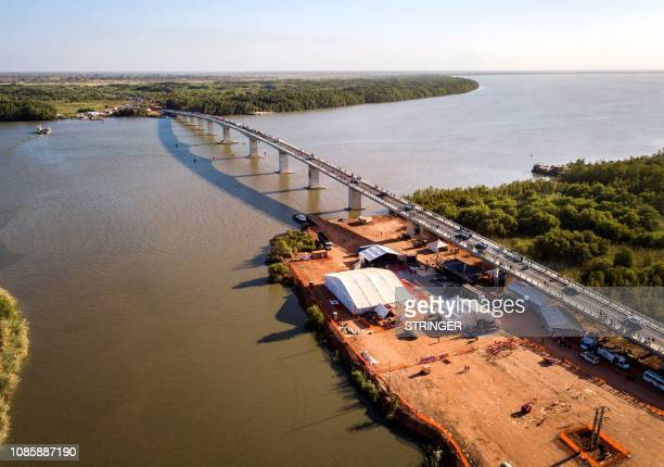 This picture shows an aerial view of people crossing the Farafenni Bridge after its inauguration by Senegal's president and Gambia's President on...