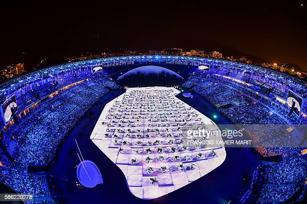 TOPSHOT This picture shows an overview during the beginning of the opening ceremony of the Rio 2016 Olympic Games at the Maracana stadium in Rio de...