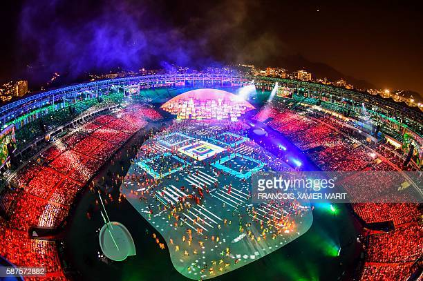 TOPSHOT This picture shows an overview during the opening ceremony of the Rio 2016 Olympic Games at the Maracana stadium in Rio de Janeiro on August...