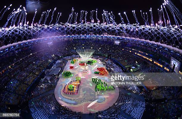 TOPSHOT This picture shows an overview of fireworks during the closing ceremony of the Rio 2016 Olympic Games at the Maracana stadium in Rio de...