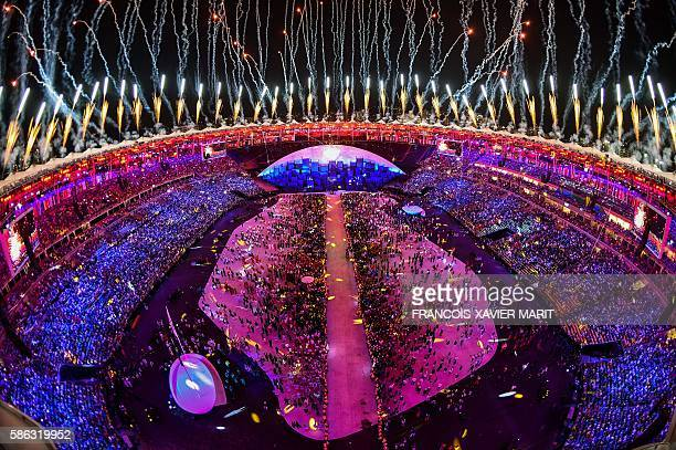 TOPSHOT This picture shows an overview of the fireworks over the Maracana stadium at the end of the opening ceremony of the Rio 2016 Olympic Games at...