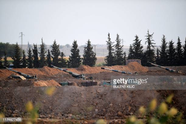 This picture shows artillery pieces on the Turkish side of the border with Syria near Akcakale in Sanliurfa province on October 8 2019 Turkey said on...
