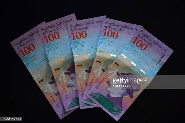This picture shows bank notes of Venezuela's bank in Caracas, Venezuela on January 15, 2019. - The president of Venezuela, Nicolás Maduro, increased...