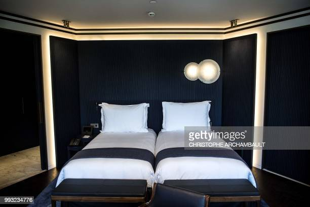 This picture shows beds in a junior suite of the newlyrefurbished Lutetia Hotel in Paris on July 6 2018 The iconic history steeped Lutetia hotel is...
