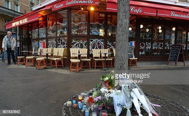 This picture shows candles and flowers in front of the brasserie Le Comptoir Voltaire near Place de la Nation in eastern Paris on the day of its...