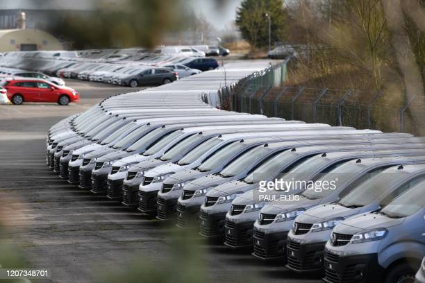 This picture shows cars parked at the Vauxhall factory in Ellesmere Port east of Liverpool after the owner French automotive group PSA announced on...
