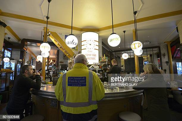 This picture shows customers at the brasserie Le Comptoir Voltaire near Place de la Nation in eastern Paris on the day of its reopening on December...