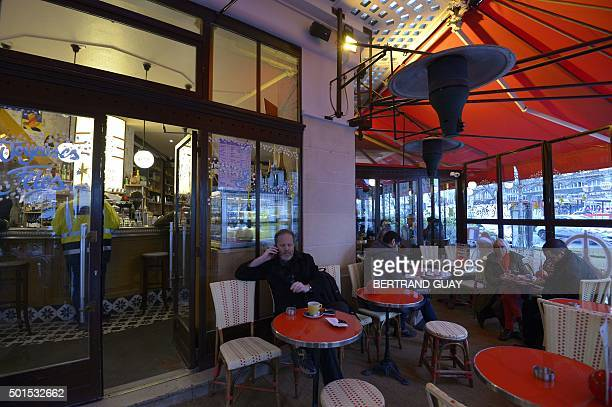 This picture shows customers on the terrace of the brasserie Le Comptoir Voltaire near Place de la Nation in eastern Paris on the day of its...