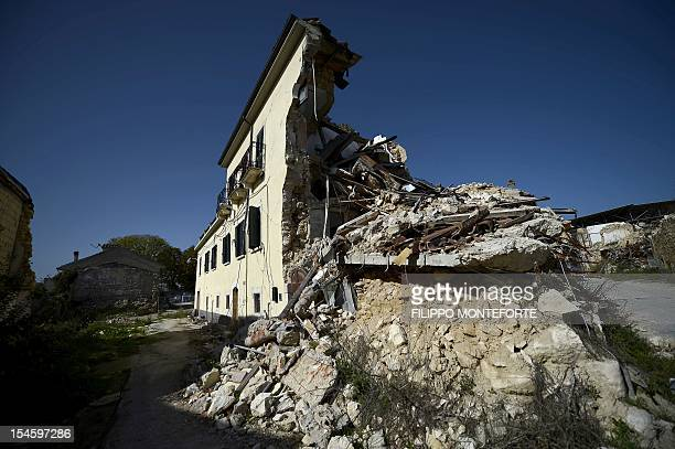 This picture shows damaged building following the 2009 earthquake on October 22, 2012 in the village of Onna. Six Italian scientists and a government...