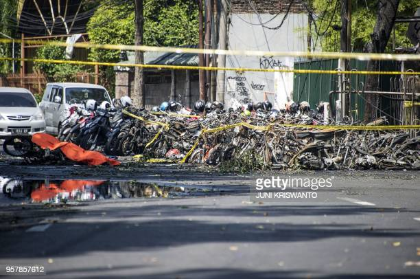 This picture shows damages following a suicide bomb outside a church in Surabaya on May 13 2018 A wave of blasts including a suicide bombing struck...