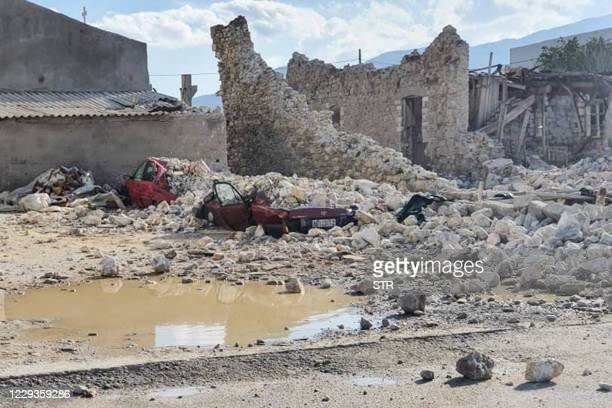 This picture shows destroyed car and collapsed buildings after an earthquake in the island of Samos on October 30, 2020. - A powerful earthquake hit...