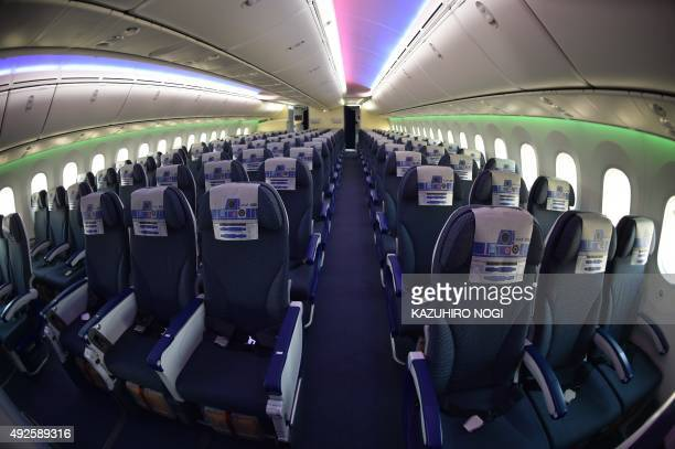 This picture shows economy class seats on board the All Nippon Airways Boeing 7879 or R2D2 ANA JET during a press preview at Tokyo's Haneda airport...