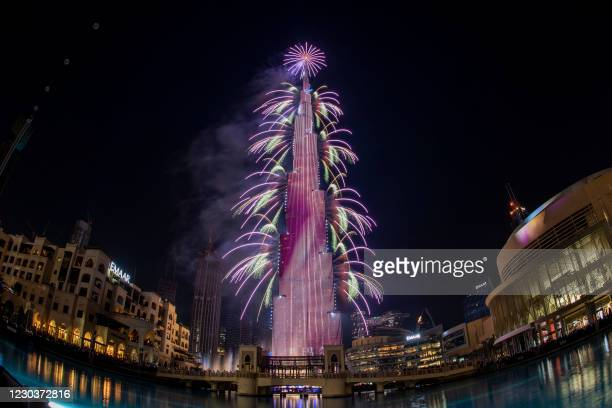This picture shows fireworks on the Burj Khalifah tower in Dubai during the new year's eve celebrations on December 31, 2020.