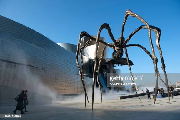"""This picture shows French-American artist Louise Bourgeois' sculpture """"Maman"""" next to the Guggenheim Bilbao Museum in the Spanish Basque city of..."""