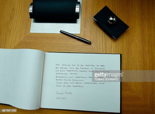 This picture shows German Chancellor Angela Merkel's message in a book of condolence at the British embassy in Berlin on May 24 following the terror...