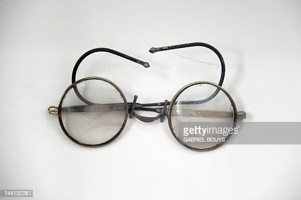 This picture shows glasses which belonged to Mohandas Karamchand Gandhi on April 28 2012 at Birla house in New Delhi AFP PHOTO / GABRIEL BOUYS
