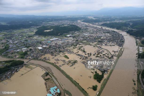 This picture shows inundated houses due to heavy rain in Hitoyoshi, Kumamoto prefecture on July 4, 2020. - Fourteen people were feared dead at a...