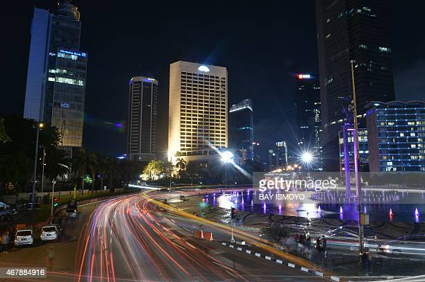 This picture shows Jakarta's business district before Earth Hour on March 28 2015 Lights will go out in some 7000 cities and towns from New York to...