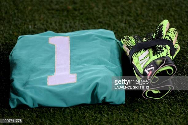 This picture shows Leicester City's Danish goalkeeper Kasper Schmeichel's gloves laying next to Ray Clemence's jersey as a tribute to the late...