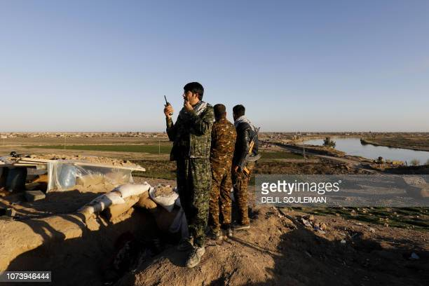 This picture shows members of the Syrian Democratic Forces in Hajin in the Deir Ezzor province eastern Syria on December 15 2018 Kurdishled forces...