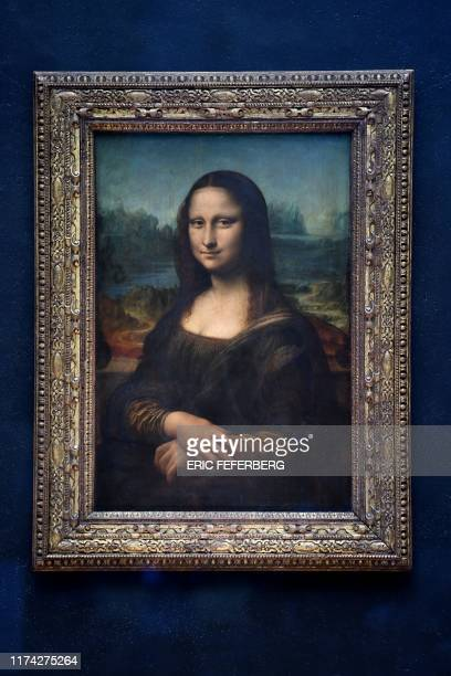 This picture shows Mona Lisa after it was returned at its place at the Louvre Museum in Paris on October 7 2019 Leonardo da Vinci's masterpiece the...