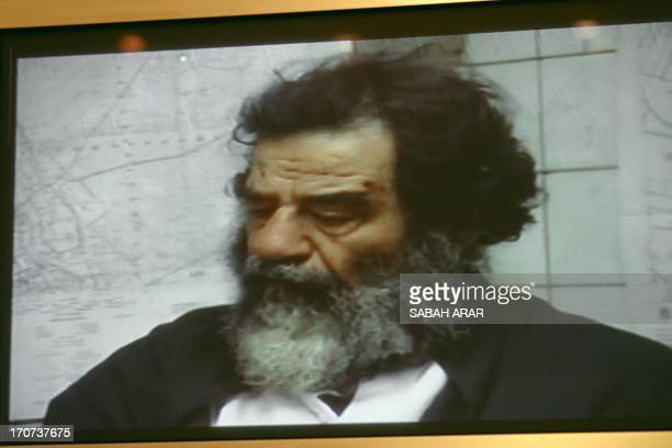 This picture shows ousted Iraqi dictator Saddam Hussein after his capture in a video presented 14 December 2003 by the US authorities during the...