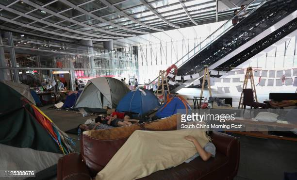 This picture shows protestors of Occupy Central beneath HSBC's headquarters in Central Two weeks ago the High Court gave them until 9pm tonight to...