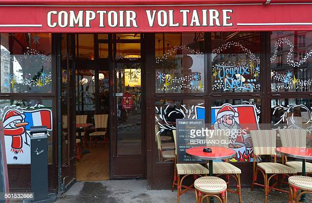 This picture shows the brasserie Le Comptoir Voltaire near Place de la Nation in eastern Paris on the day of its reopening on December 16 a month...