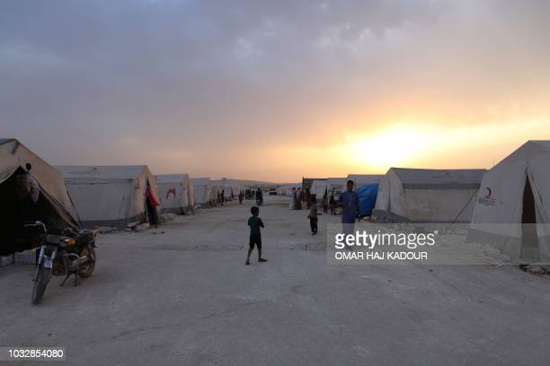 This picture shows the camp 'Hope' at sunset in the Syrian village of Kafr Lusein north of the Bab alHawa border crossing on September 13 2018