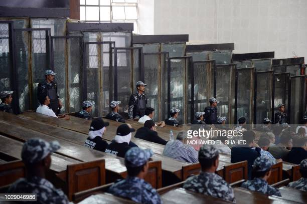 This picture shows the courtroom and soundproof glass dock during the trial of 700 defendants including Egyptian photojournalist Mahmoud Abu Zeid...