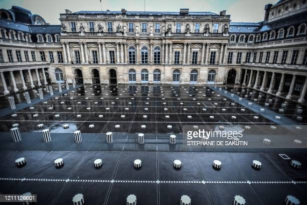 """This picture shows the deserted court of honour with the """"Colonnes de Buren"""" designed by French conceptual artist Daniel Buren at the closed Palais..."""