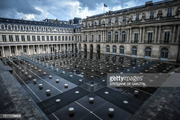 This picture shows the deserted court of honour with the Colonnes de Buren designed by French conceptual artist Daniel Buren at the closed Palais...