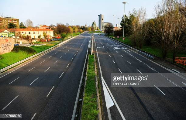 This picture shows the empty Viale Alcide de Gasperi usually one of the busiest roads of Milan on March 22 2020 Italian Prime Minister Giuseppe Conte...